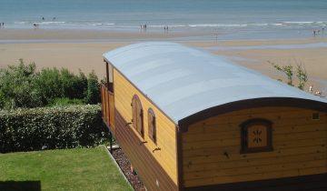 Camping de La Plage Houlgate-roulotte vue mer-Les Pieds dans l'Eau